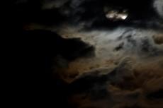 雲のかかった月の写真素材