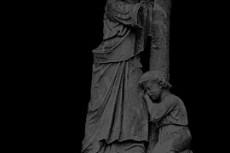 十字架と石像の写真素材