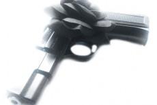 銃と黒い薔薇の写真素材