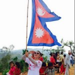 nandita-kC-with-nepal-flag.jpg