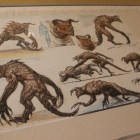 Fallout 3 Deathclaw concept art on display.