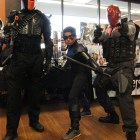 Deathstroke, Nightwing, and Red Hood all pose for the camera.