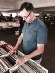 Dave flipping through the records at Vintage Garage Chicago