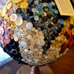 Cover a globe with buttons, chalkboard paint, or just let it be