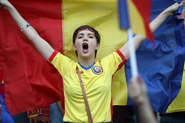 A Romania supporter gestures and shouts prior to the start of the Euro 2016 group A football match between France and Romania at Stade de France, in Saint-Denis, north of Paris, on June 10, 2016. / AFP PHOTO / KENZO TRIBOUILLARD