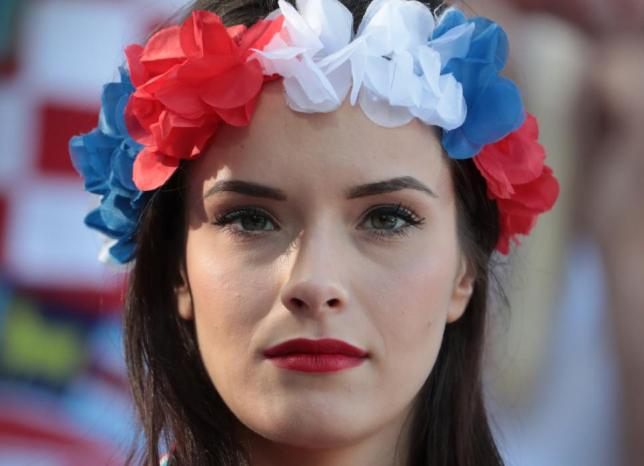 A Croatia supporter smiles before the round of sixteen football match Croatia against Portugal of the Euro 2016 football tournament, on June 25, 2016 at the Bollaert-Delelis stadium in Lens. / AFP PHOTO / KENZO TRIBOUILLARD
