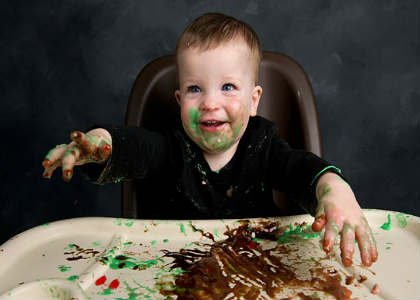 This is a messy baby in a high chair.