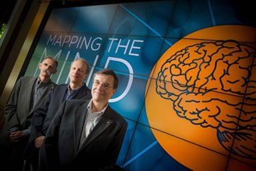 The image shows Ralph Greenspan and other researchers involved in the cal-BRAIN initiative.