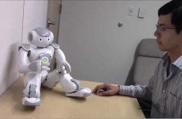Image shows a the researcher and robot.
