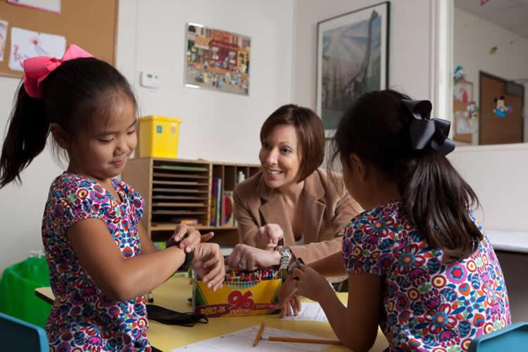 Image shows the researcher with 2 little girls.