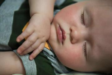 Image shows a sleeping baby.