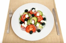 Image shows a plate of med style salad.
