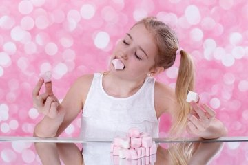 girl eating marshmallows