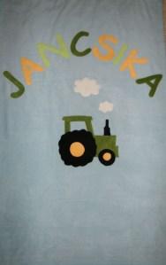 John Deer traktor világoskék lapon