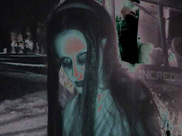 A female ghoul wanders near as the hayride approaches.