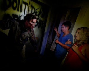 The Walking Dead terrorize victims in the Dead Inside maze at Halloween Horror Nights 2012