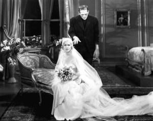 The Monster (Karloff) stalks Frankenstein's bride (Mae Clarke).