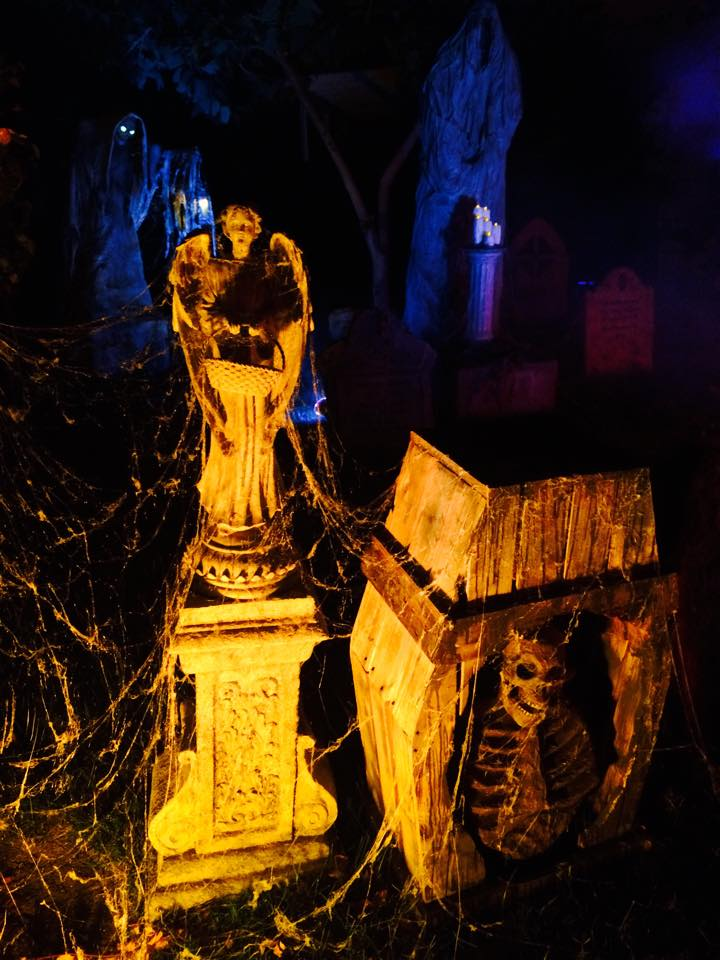 Mourning Rose Manor statue and skeleton in coffin