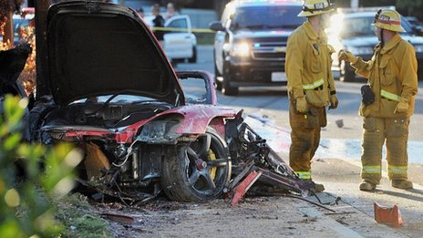 Wreckage of Porsche sports car that crashed into a lamp post in Valencia, Los Angeles. 30 Nov 2013