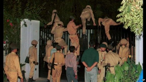 Pakistan Army Soldiers climb gates of Pakistan TV headquarters during coup to remove democratically elected government - October 12 1999
