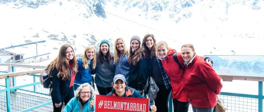 "Students holding a sign that says ""Belmont Abroad"" in Switzerland"