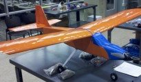 """The unmanned aerial vehicle, """"dressed"""" in U.Va.'s colors. The plane was built entirely from parts from a 3-D printer."""