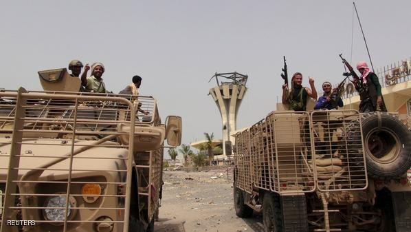 Southern Resistance fighters ride armoured personnel carriers at the international airport of Yemen's southern port city of Aden, July 14, 2015. Gulf-backed Yemeni forces recaptured Aden's international airport from Houthi militia fighters on Tuesday as heavy combat took place across the port city following the collapse of a humanitarian truce, the exiled government said. REUTERS/Stringer