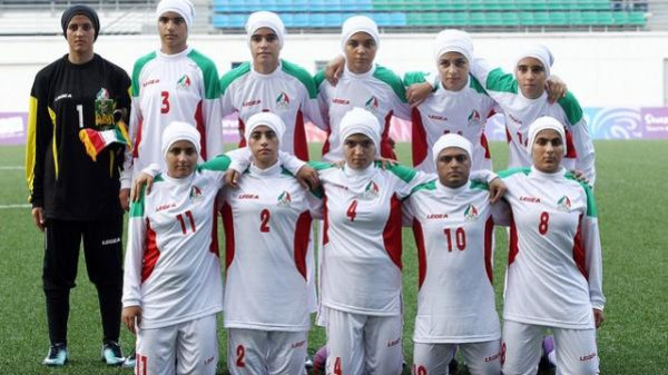 Iran's girls' football team pose for a group picture before the start of Turkey versus Iran girls' preliminary match of the Singapore 2010 Youth Olympic Games (YOG) played at the Jalan Besar Stadium in Singapore, Aug 12, 2010. Photo: SPH-SYOGOC/Seyu Tzyy Wei
