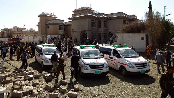 Red Crescent ambulances are parked at the scene of a car bomb which struck the residence of Iran's ambassador (background) in the Yemeni capital Sanaa on December 3, 2014, killing at least one person and wounding 17 others, according to security officials and witnesses. Ambassador Hassan Sayed Nam was not in the house when the attack took place in the diplomatic district of Hada, according to a security official.  AFP PHOTO / MOHAMMED HUWAIS        (Photo credit should read MOHAMMED HUWAIS/AFP/Getty Images)