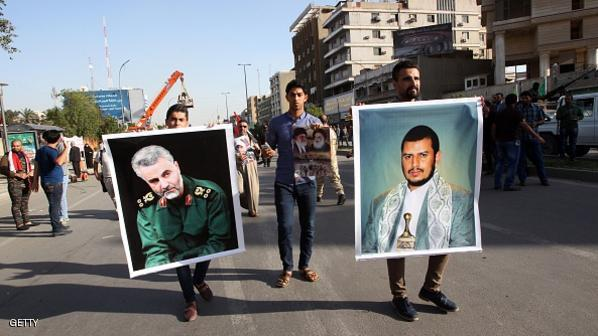 An Iraqi holds a portrait of Shiite Huthi rebels' leader in Yemen, Abdulmalik al-Huthi (R) and General Qassem Suleimani (L), the commander of the Quds Force, the foreign operations arm of Iran's Revolutionary Guards, during a demonstration to protest against the Saudi-led Arab coalition which is carrying out air strikes on Huthi militia targets across Yemen on March 31, 2015 in Baghdad's landmark Firdous square.  AFP PHOTO / ALI AL-SAADI        (Photo credit should read ALI AL-SAADI/AFP/Getty Images)