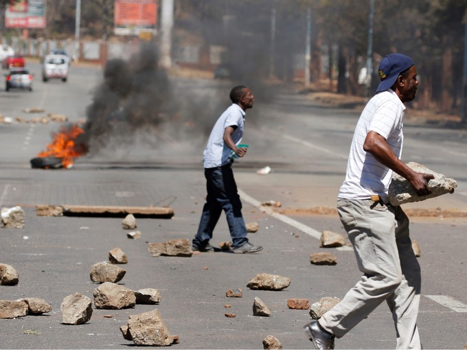 Opponents of Robert Mugabe armed themselves with rocks during the clashes.