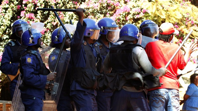 Riot officers armed with shields and batons clashed with demonstrators.