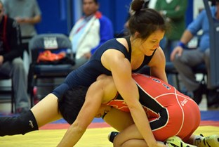 Nicole Woody and Clarissa Chun wrestle for position at the Dave Schultz Memorial International wrestling tournament. (Jasmine Cannon/MEDILL)