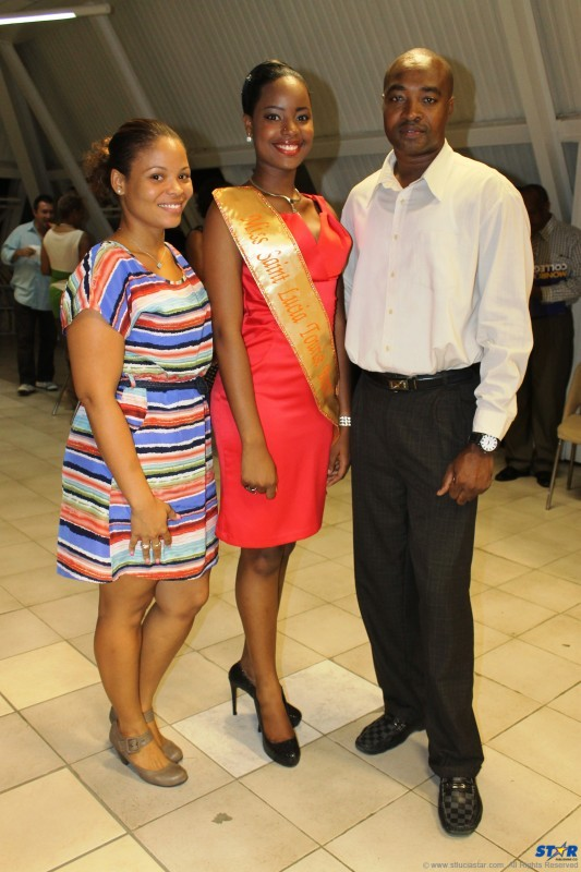 Miss SLTB Amy Stephen (center) with her chaperone and the SLTB's John Emmanuel.