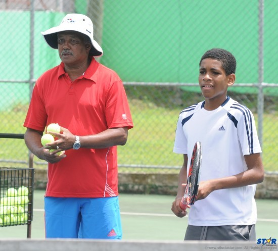 Coach Earl Blanchard and grandson Ronel Blanchard at the summer camp hosted by Tiger Tennis and the St Lucia Tennis Association Incorporated.