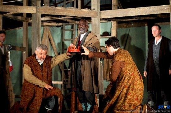Joseph Marcell (center) as the comical then heart-rendingly pathetic father.