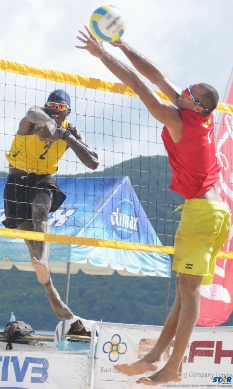 St Lucia's Joseph Clercent (L) during play in the first set against Puerto Rico.