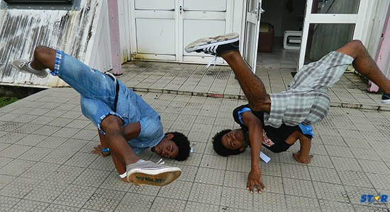 Break-dance fanatics Francis Butcher (L) and Kensley Hippolyte (R) bust a move for the STAR.
