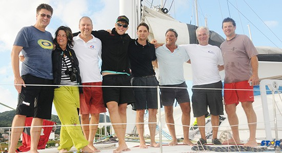Skipper Rainer Holtorff (fifth from the left) and crew members on board Malisi.