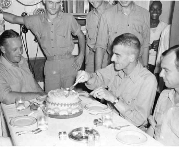 Sailors and Marines cut a slice of good luck cake the night before the raid.U.S. Naval Institute Archives