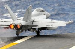 (June 3, 2012) An EA-18G Growler from the Shadowhawks of Electronic Attack Squadron (VAQ) 141 launches off the flight deck of the Navy's forward-deployed aircraft carrier USS George Washington (CVN 73). Growlers would be an essieintal component of a Syrian air intervention. U.S. Navy Photo.