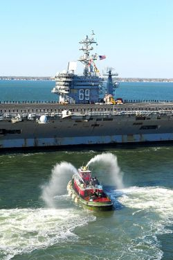he aircraft carrier USS Dwight D. Eisenhower (CVN 69) makes its approach pierside at Naval Station Norfolk after a six-month deployment to the U.S. 5th and 6th Fleet areas of responsibility. US Navy Photo