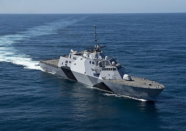 USS Freedom will deploy March 1 for Singapore with a new paint pattern inspired by World War II ship camouflage. US Navy Photo