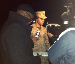 Marine Base Quantico, spokesman Lt. Agustin Solivan briefs reporters following a shooting incident on the base March 22, 2013.