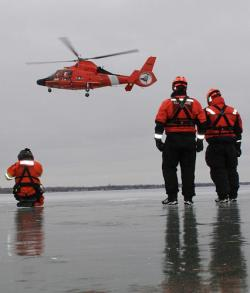 Coast Guardsmen from Air Station Detroit and Station St. Clair Shores, Mich., conduct joint ice-rescue training on Lake St. Clair, Feb. 12, 2013. US Coast Guard Photo