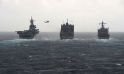 USNS Robert E. Peary (T-AKE 5), center, conducts a dual replenishment-at-sea with the amphibious assault ship USS Kearsarge (LHD 3) and the amphibious landing dock ship USS Carter Hall (LSD 50) on Feb 13. US Navy Photo