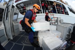 Crew members aboard the Coast Guard cutter Valiant transfer bales of contraband to  Coast Guard Station Miami on Feb. 19, 2013. US Coast Guard Photo