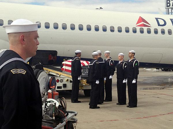 Members of the U.S. Navy Ceremonial Guard conduct a transfer of remains ceremony at Washington Dulles International Airport on March 7 for two sailors from the USS Monitor. US Navy Photo