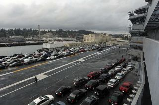 Sailors' vehicles are parked on the flight deck of the aircraft carrier USS Ronald Reagan (CVN-76) on March, 13 2013. US Navy Photo