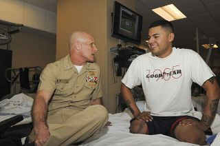Marine Cpl. Jorge Salazar at Naval Medical Center San Diego's (NMCSD) Wounded Warrior Battalion-West detachment, speaks to Deputy Commander, U.S. Central Command, Vice Adm. Robert S. Harward in January.